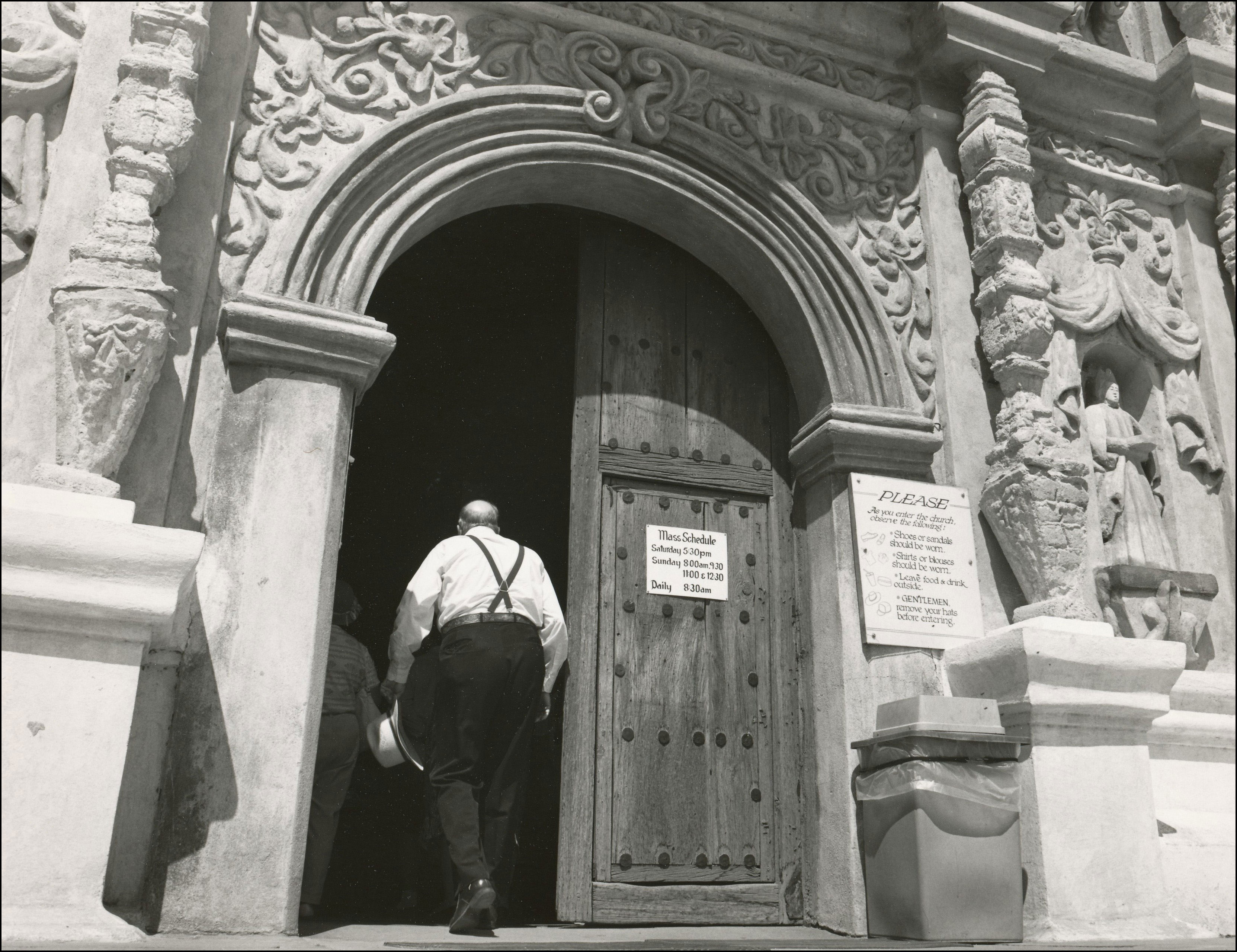 Man walking into the door of a sanctuary