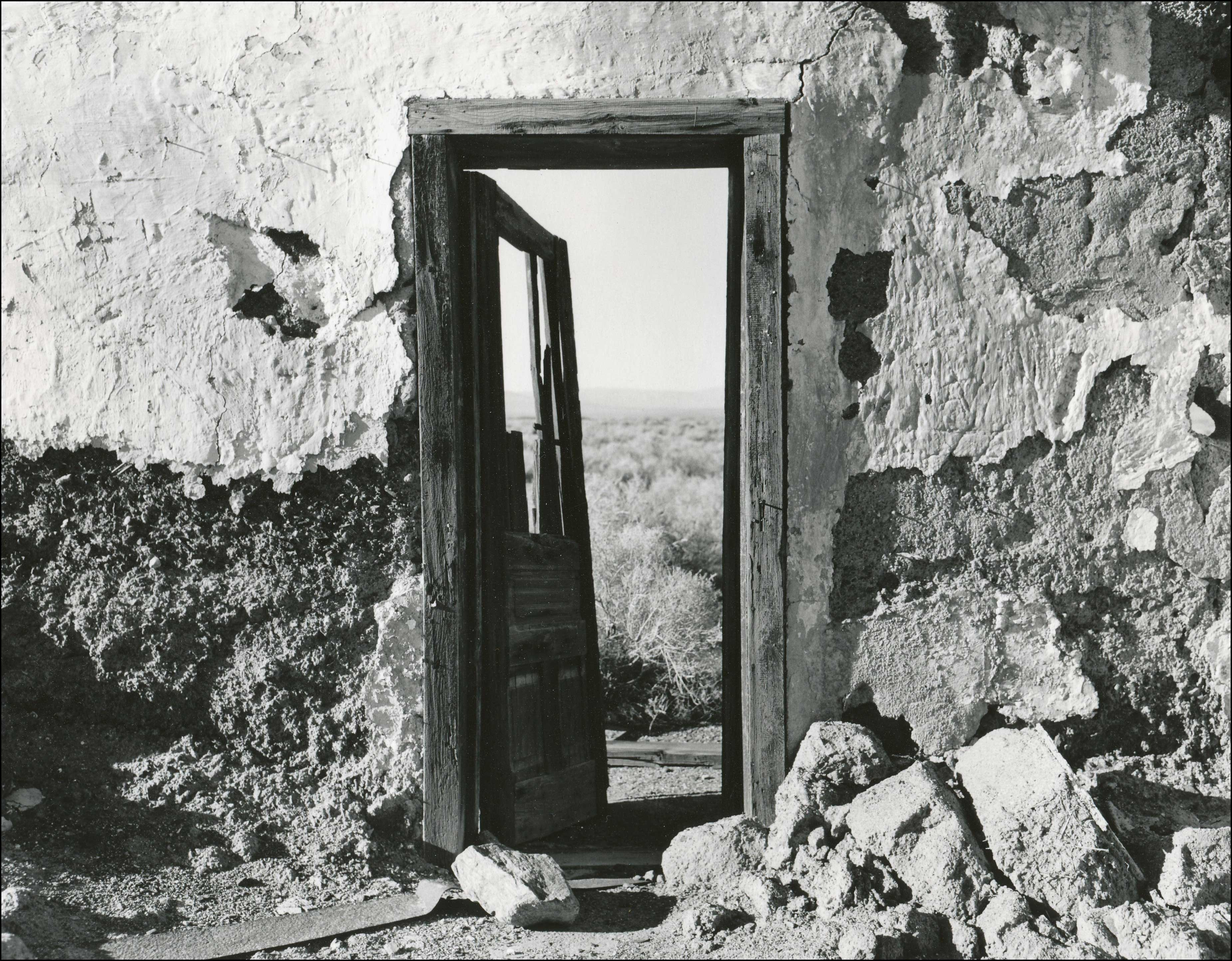 open door with wood frame still set in very old building