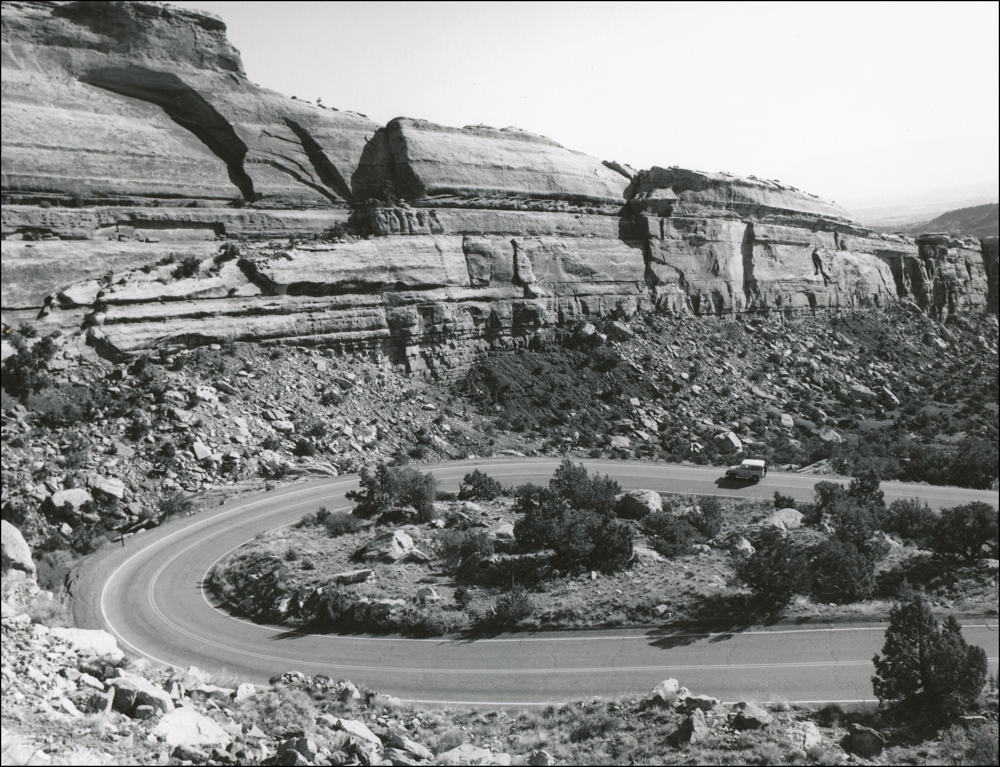 Large switchback on a paved road in a rocky mountain area